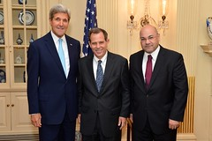 U.S. Secretary of State John Kerry, U.S. Ambassador-designate to Iraq Stuart Jones, and Iraqi Ambassador to the United States Lukman Faily at the swearing-in ceremony for Ambassador Jones at the U.S. Department of State in Washington, D.C., on September 17, 2014. [State Department photo/ Public Domain]