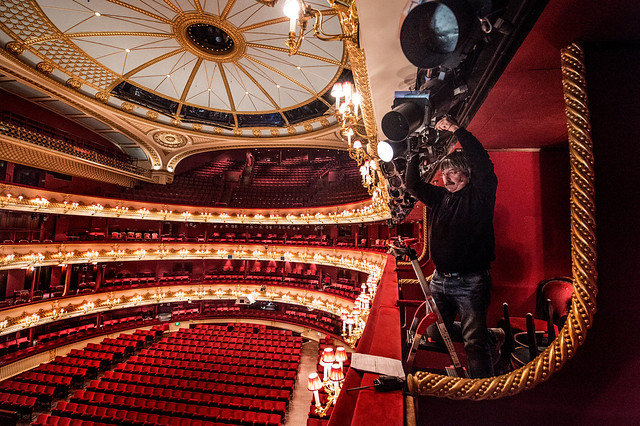 Lighting staff member Peter Curtis focusing lights in the auditorium of The Royal Opera House © ROH 2016. Photograph by Sim Canetty-Clarke