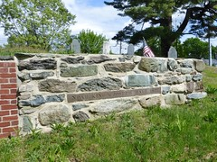 Stone wall with grave marker