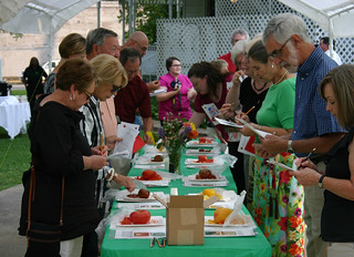 Picture of attendees tasking tomatoes at the Trotter