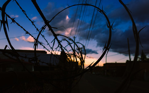 sunset barbedwire seattle georgetown sky sharp rusty pacificnorthwest pnw urban industrial pointy washington johnwestrock