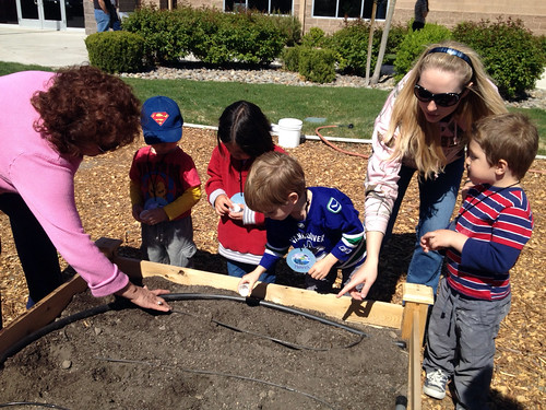 From left to right: Nevada NRCS employee Consuelo Navar, Supply Clerk, helps preschoolers from One World Children's Academy plant seeds in the People's Garden, along with a parent helper. Photo by One World Children's Academy.