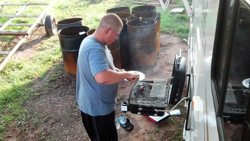 Matt cooking at the camper
