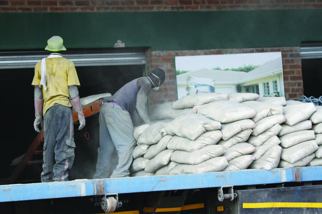 Casual workers in Zimbabwe usually work for long hours without safety clothing. Labour unions say that many employees are hiring people as casual staff to avoid providing benefits. Credit: Michelle Chifamba/IPS