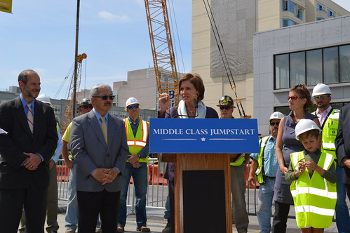 Congresswoman Pelosi discusses the Middle Class Jumpstart at Central Subway construction