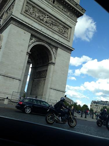 Going around the Arc de Triomphe in car, Paris