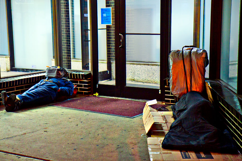 Two-people-sleeping-outside-empty-space-on-9-14-14--Center-City