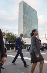 U.S. Secretary of State John Kerry checks his cellphone as he departs the United Nations Headquarters in New York following a Security Council discussion about Iraq on September 19, 2014. [State Department photo/ Public Domain]