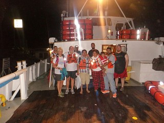 Four adults and 1 child who were rescued by Good Samaratians and the Coast Guard, stand on the Tug boat Signet Challenger after being pulled off their sinking sailing vessel, Sept. 12. U.S. Coast Gaurd photo.