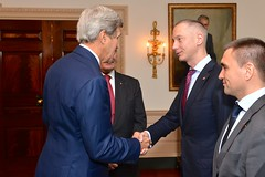 With Ukrainian President Petro Poroshenko looking on, U.S. Secretary of State John Kerry greets a member of the Ukrainian Presidential Delegation before his meeting with President Poroshenko at the U.S. Department of State in Washington, D.C., on September 18, 2014. [State Department photo/ Public Domain]