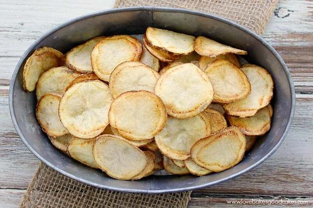 Homemade Potato Chips in a metal bowl looking from the top down.