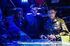 U.S. Navy and ROK Navy sailors work together in the combat information center aboard USS Kidd (DDG 100). (U.S. Navy/MC2 Declan Barnes)