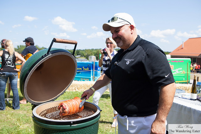 Chef of Heron Hill cooking/smoking the bacon wrapped porchetta in the Big Green Egg