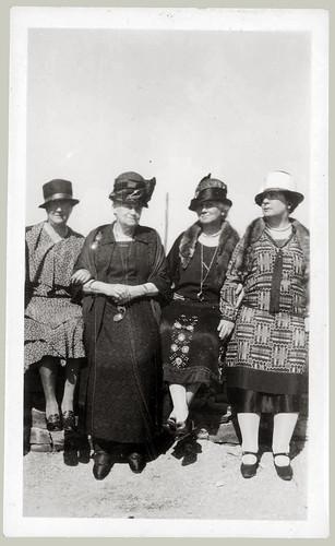 Four women in hats