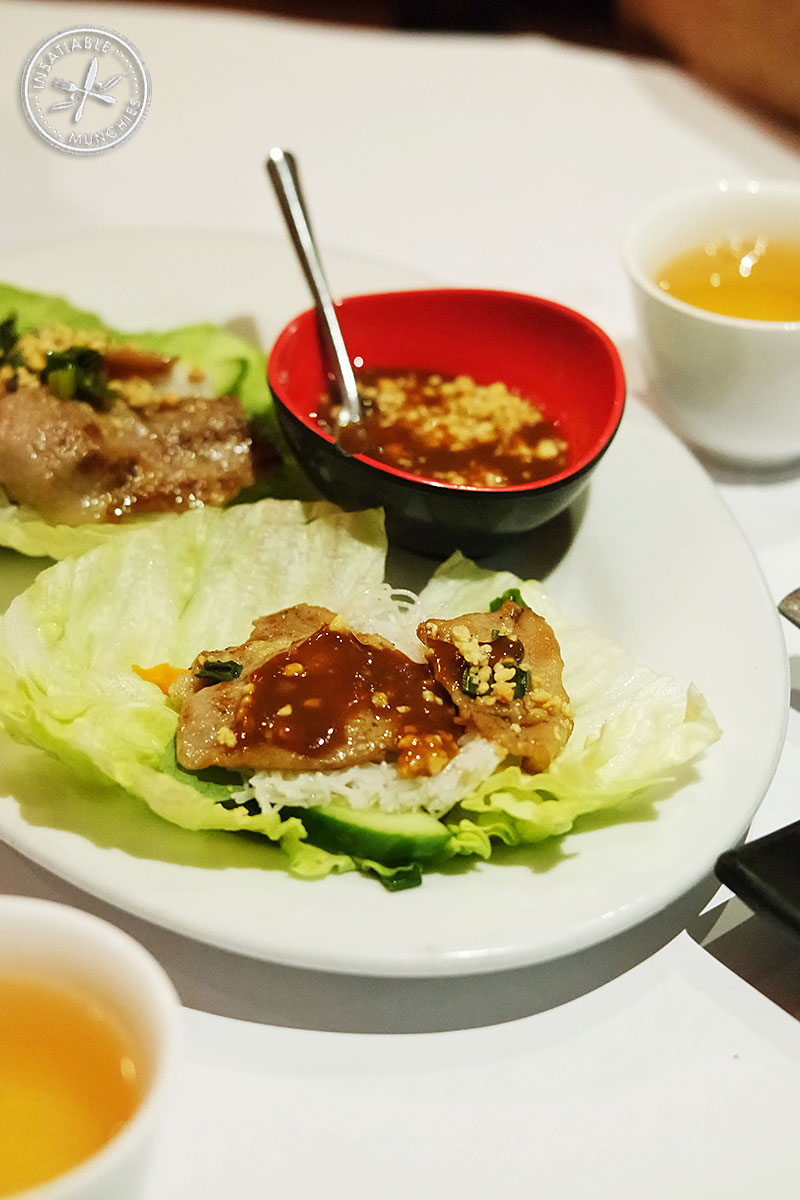 Marinated pork, grilled on a skewer, wrapped in lettuce with special rice noodle cakes, pickles, mint and Bay Tinh's special sauce.