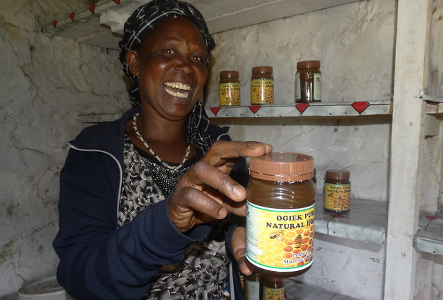Mary Ondolo, 50, shows a package of honey made by the Ogiek women and packaged and refined by the Mariashoni Community Development, a community-based organisation. Credit: Robert Kibet/IPS
