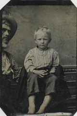 """Hidden father"" tintype portrait of a boy"