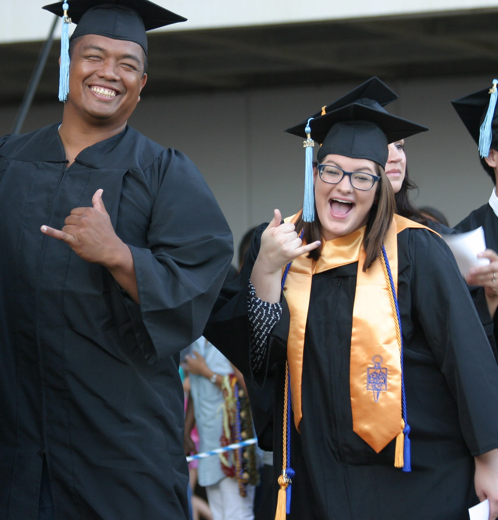 """<p>Student Government President Amanda Bird receiving her degree at at Leeward's commencement ceremony at Tuthill Courtyard on May, 16, 2014. For more photos go to <a href=""""https://www.flickr.com/photos/leewardcc/sets/72157644342097098/"""">www.flickr.com/photos/leewardcc/sets/72157644342097098/</a></p>"""