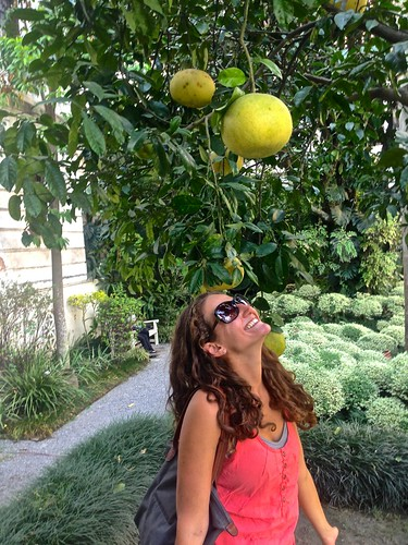 Lina and a huge fruit in the Garden of Dreams