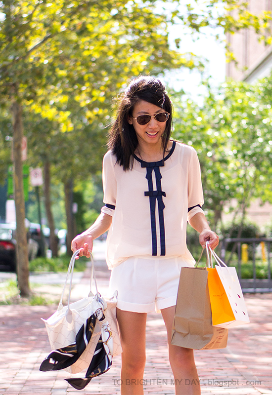 bow blouse, white cuffed shorts, chain scarf, white tote bag
