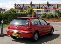 race car(0.0), sedan(0.0), honda cr-x(0.0), sports car(0.0), automobile(1.0), automotive exterior(1.0), wheel(1.0), vehicle(1.0), honda(1.0), land vehicle(1.0), coupã©(1.0),