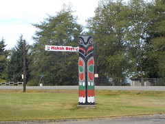 sculpture(0.0), memorial(0.0), traffic sign(0.0), totem pole(1.0), signage(1.0), tree(1.0), totem(1.0),