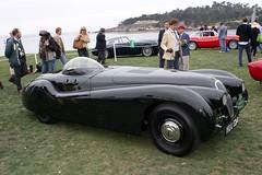 race car, automobile, jaguar xk120, vehicle, automotive design, antique car, classic car, vintage car, land vehicle, luxury vehicle, supercar, sports car,