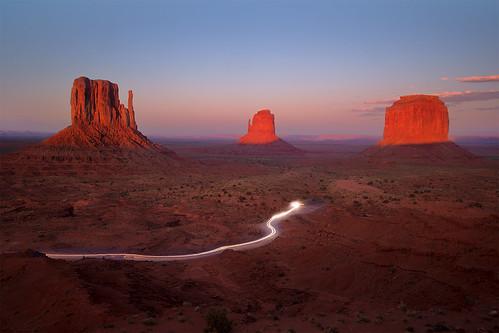 road light sunset red southwest monument rock landscape utah trail valley