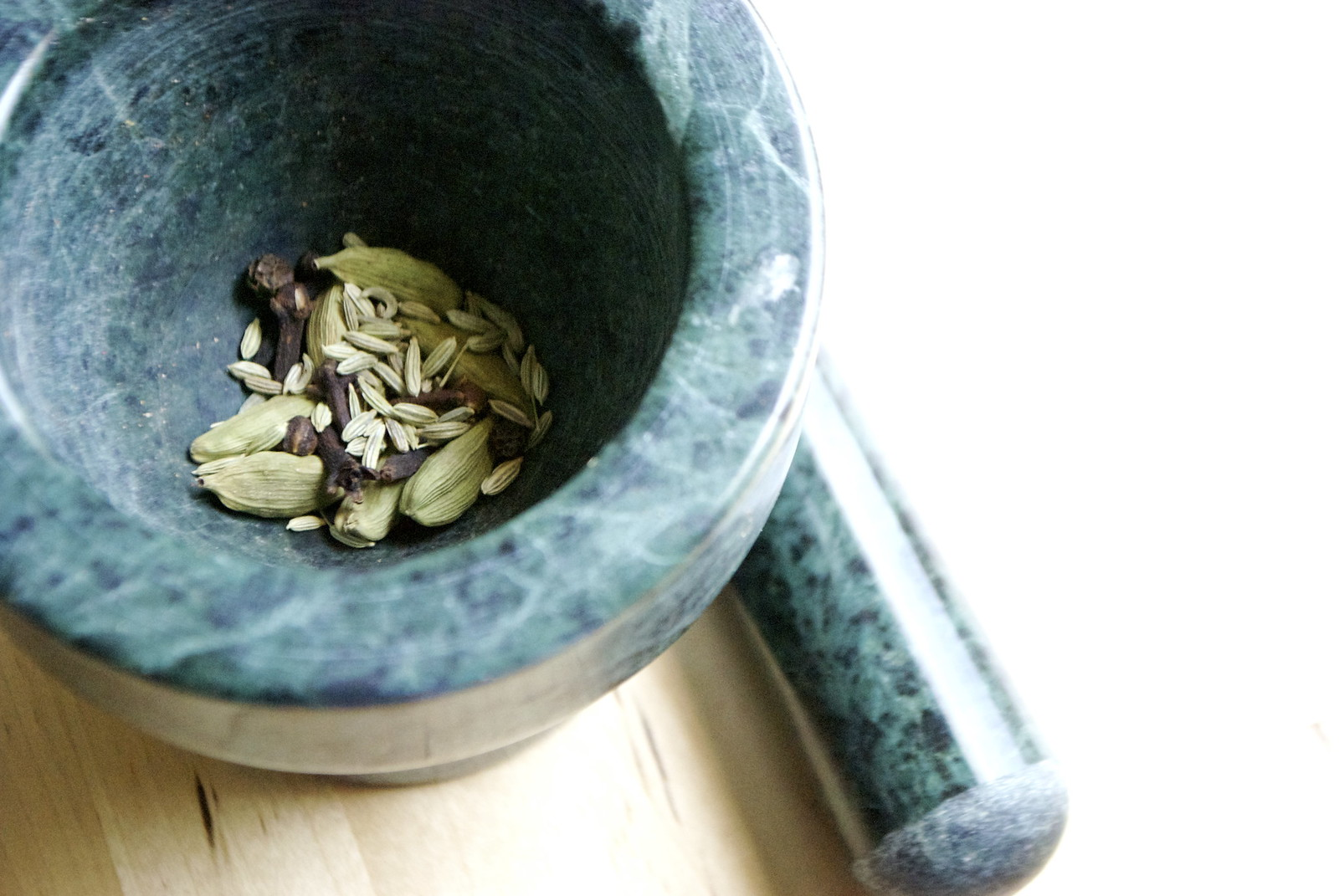 spices in a mortar and pestle