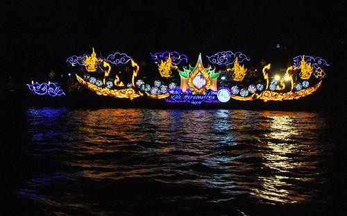 Illuminated Boat Going Down the Chao Phraya River during Bangkok's Loi Krathong