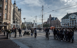 Image of Dam Square near Amsterdam. damsquare publicspace amsterdam crowds tourists streetscene november groups
