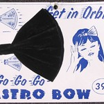 Fri, 2017-01-20 16:43 - 'Astro Bow. Get in orbit. Go-go-go. 39¢. Buser Century, Inc.'  A black velvet hair bow shaped like a space capsule!   'Get in Orbit' and 'Go Go Go' with 'Astro Bow' is what the printed card is telling us.  What Space Age gal could resist something like this?