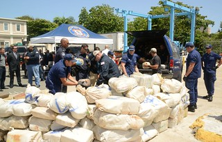 Coastguardsmen alongside Federal Bureau of Investigation, the Drug Enforcement Administration, U.S. Customs and Border Protection and Immigrations and Customs Enforcement law enforcement personnel load 3,591 pounds of marijuana for transportation to a secure facility following an interagency press conference at Sector San Juan, Puerto Rico July 21, 2014. The Coast Guard and federal law enforcement partner agencies announced the interdiction of the motor vessel An Nur, where 3,591 pounds of marijuana, estimated to have a wholesale value of $3.5 million dollars were seized, while the 5-man Guyanese crew was detained for prosecution. (U.S. Coast Guard photo by Ricardo Castrodad, Sector San Juan Public Affairs specialist.)