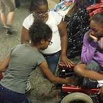 Zwena, Raven and Bettie working on the wheelchair go kart