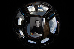 Portrait of Georges Lemaître floating in the Cupola of the ISS
