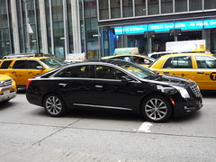 automobile(1.0), executive car(1.0), cadillac(1.0), wheel(1.0), vehicle(1.0), cadillac xts(1.0), mid-size car(1.0), cadillac cts(1.0), sedan(1.0), land vehicle(1.0), luxury vehicle(1.0),