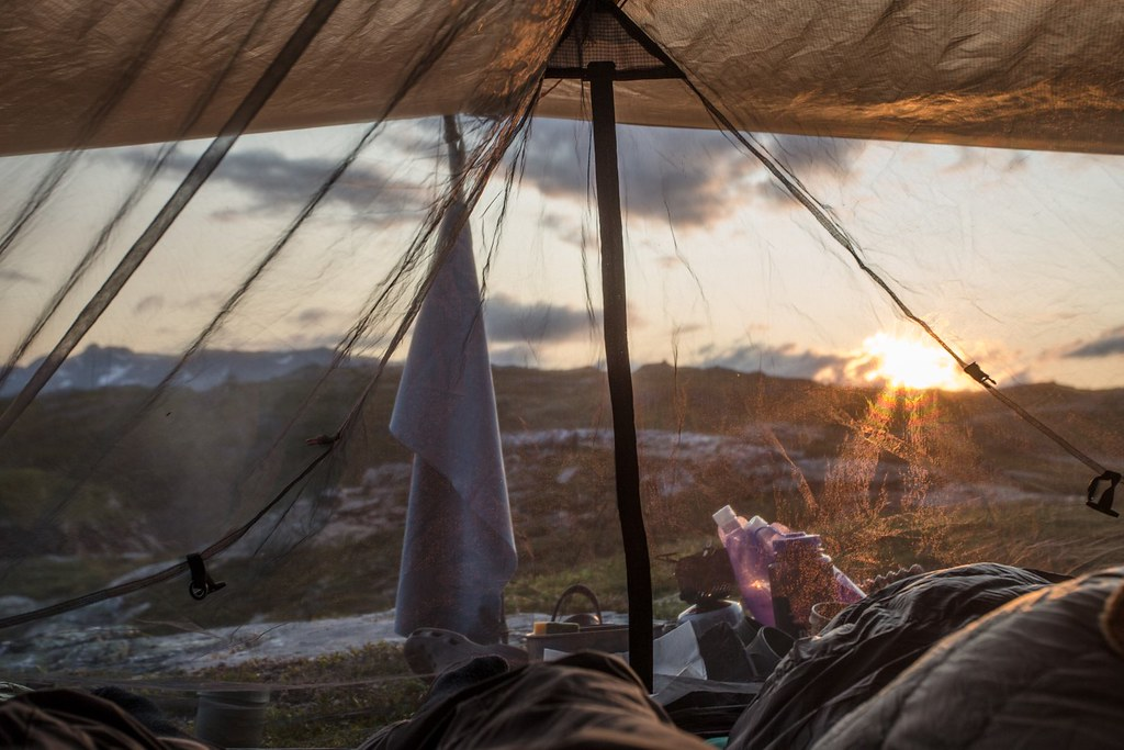 Inhaling the day's last rays of light. The Oooknest from our faded MSR Twing Tarp perfectly fits under the MLD Trailstar (with some minor adaptions). Contrary to the expected we met little flying critters. Hardangervidda NP. Norway.