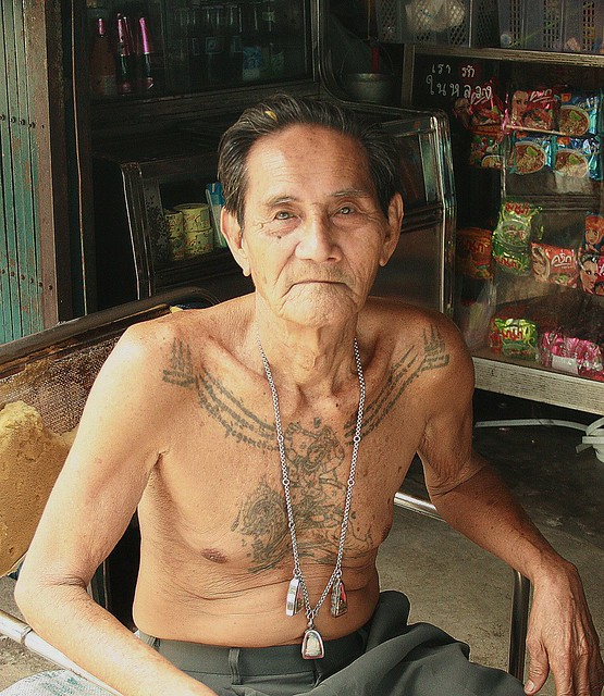 older man with tattoos