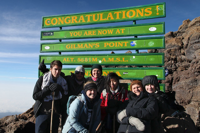 Lindsay celebrating the summit with the seniors (Mt. Kilimanjaro, Tanzania)