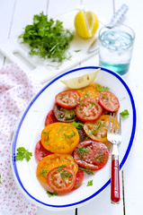 Colorful tomato salad green parsley and lemon whit…