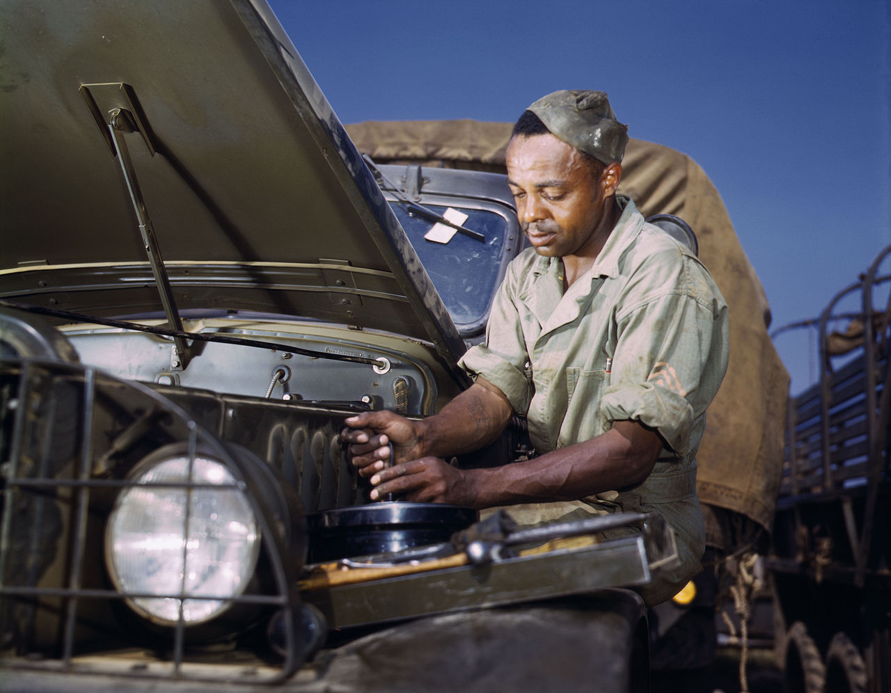 Cleaning the air filter of an army truck 1942