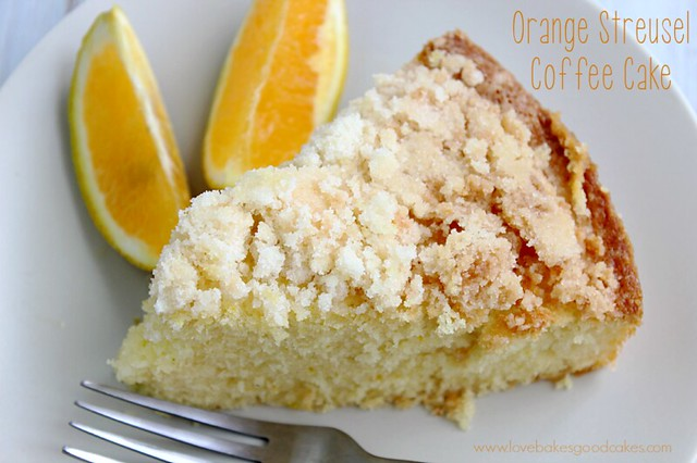 Orange Streusel Coffee Cake on a plate with orange slices and a fork.