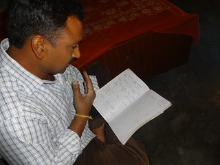 Manjit Singh, Kohli of Mjatley village, looking at his attendance register which has seen a steep fall over the years..