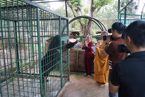 Buddhist monk blesses Nhan Ai - as media looks on