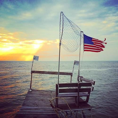 #lake #water #flag #wind #usa #patriotism #pier #net #fishing #lynnfriedman
