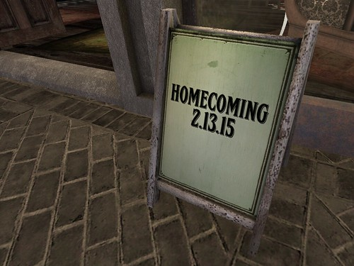 Image Description: A Placard with 'Homecoming' written on it.