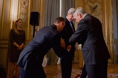 Vanessa Kerry, the daughter of U.S. Secretary of State John Kerry, looks on as French Foreign Minister Jean-Marc Ayrault  awards the Secretary the Grand Officer of the Légion d'honneur, the second-highest level of the French award, during a ceremony on December 10, 2016, at the Quai d'Orsay - the French Foreign Ministry - in Paris, France. [State Department Photo/ Public Domain]