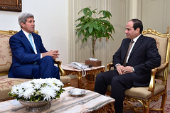 U.S. Secretary of State John Kerry chats with Egyptian President Abdel Fattah al-Sisi at the Presidential Palace in Cairo, Egypt, on July 22, 2014, to discuss a possible ceasefire between Israeli and Hamas forces fighting in the Gaza Strip. [State Department photo/ Public Domain]