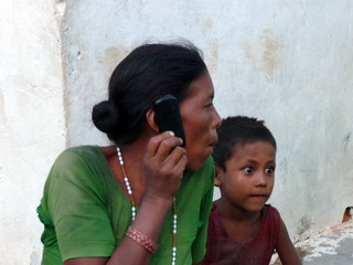 Ram Dwari on the phone with her daughter