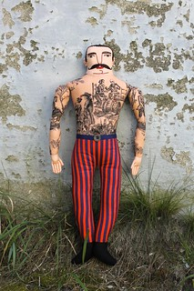 mustache man with skeleton tattoos
